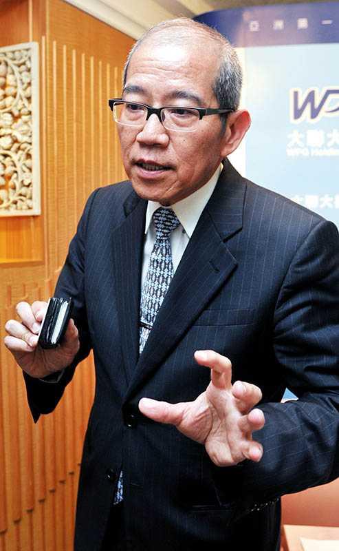 大聯大董事長(右)黃偉祥自2005年起啟動策略併購,讓公司10年業績締造5,000億元版圖。(圖/報系資料庫)
