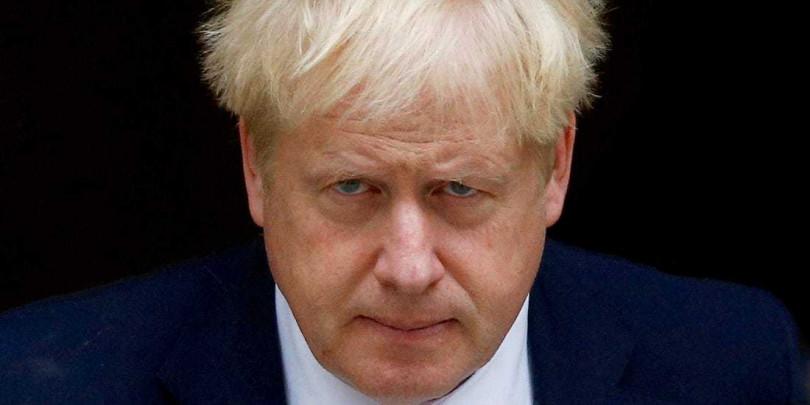 強生「佛系防疫」,遭嗆根本棄甲投降。然而時過多日,英國「放給他去」作法被認為是高招!(圖/Business Insider)