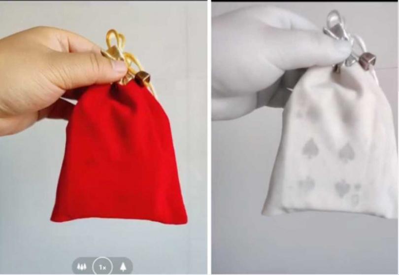 透過「OnePlus」手機中的「秋意」濾鏡,可以大致看到袋子中的撲克牌花色。(圖/翻攝自澎派新聞)