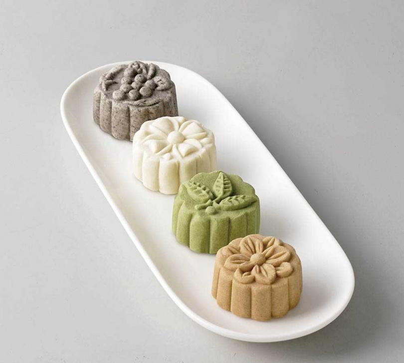 「狀元糕」純靠油脂潤滑,除了杏仁、芝麻等口味,還有風味像蔬菜加抹茶的「麻芛」(前二)口味。(中狀元糕4入/580元)(圖/林金生香提供)