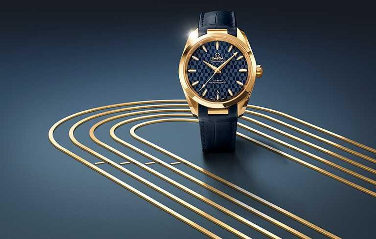 OMEGA「Seamaster海馬」系列,Aqua Terra 150米「東京2020」腕錶,38mm,18K黃金錶殼,8901型同軸擒縱大師天文台機芯╱581,000元。(圖╱OMEGA提供)