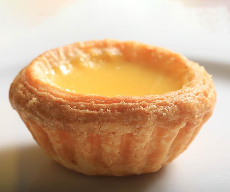 擘酥蛋塔的酥脆外皮和香甜內餡的美味,促使李德全走上廚師之路。