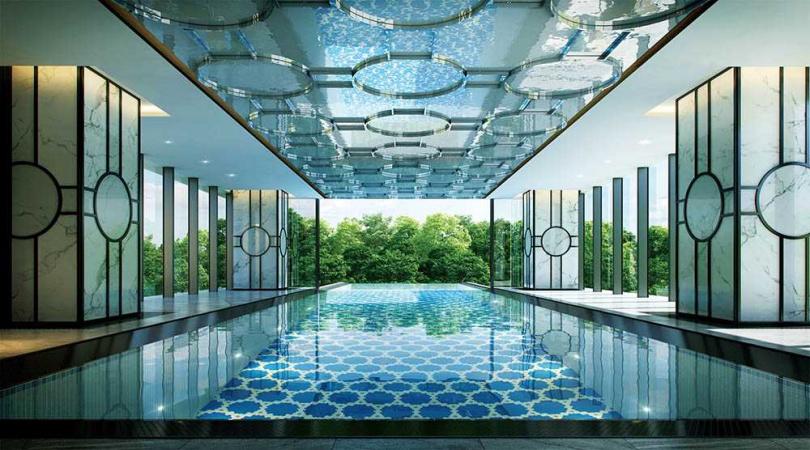 「潤泰敦峰」公設由知名的新加坡eco.id團隊操刀,以馬爾地夫度假飯店為設計概念。位於3樓半的無邊際泳池,可從室內游向戶外樹海之中。(圖/業者提供)