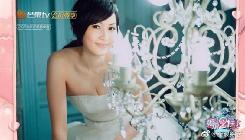 吳尊妻子林麗吟,早年為了幫老公顧形象,獨自拍了「一個人的婚紗照」。(圖/翻攝微博)