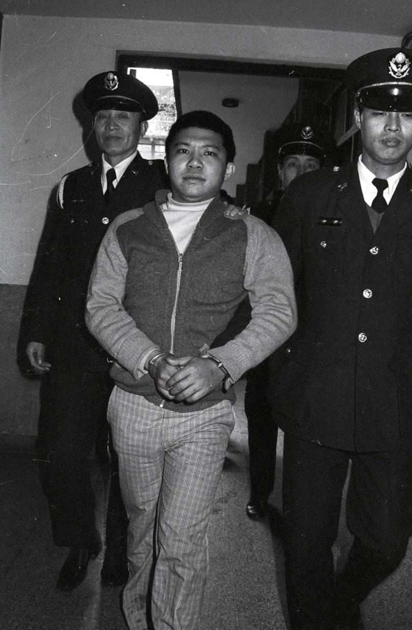林憲坤出庭時常露出詭異微笑。