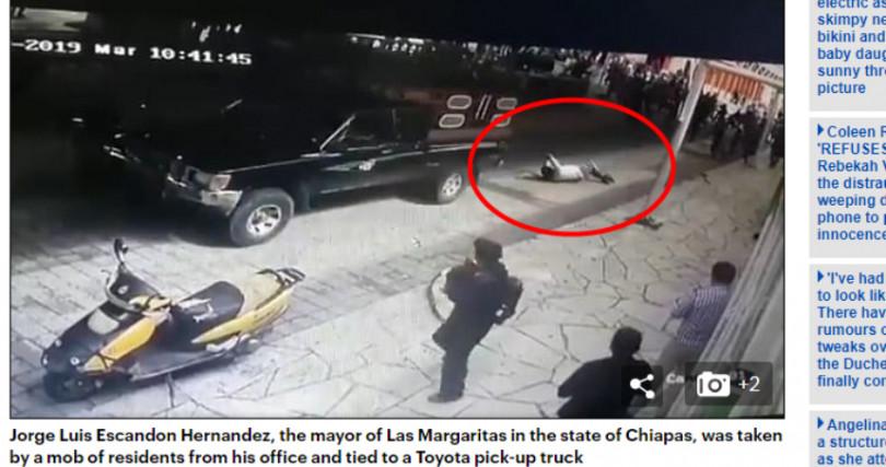 市長被市民綁在貨車後方拖行數公尺。(圖/翻攝自每日郵報)